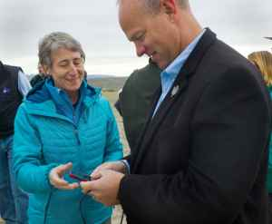 Gov. Matt Mead views a photograph Secretary of the Interior Sally Jewell has just taken of antelope migrating near Trappers Point in Sublette Ccounty last fall. In 2013, Mead vetoed portions of a federal land transfer study that would have funded his staff's involvement, citing a legal analysis by his attorney general. Jewell's agency oversees the BLM, which manages more than 17 million acres of federal property in Wyoming that some lawmakers would like to see turned over to the state. (Angus M. Thuermer Jr/WyoFile)