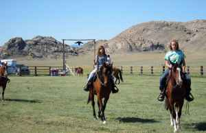 Neighbors bring their horses to the Pathfinder Ranch's annual Pathfinder Days celebration. (Dustin Bleizeffer/WyoFile)
