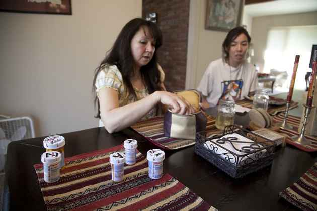 Melanie Charette pulls out her daughter, Breanna Charette's, medication for her epilepsy. Breanna was first diagnosed with epilepsy when she was seven years old. Her medication gives her terrible side effects and the Charette family hopes medical marijuana might be a better treatment.