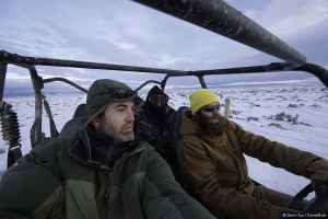 """Gerrit Vyn, principle videographer (left), and Marc Dantzker, producer ride with assistant Jamie Drysdale while working on the film """"Sagebrush Sea."""" (Courtesy Gerrit Vyn)"""