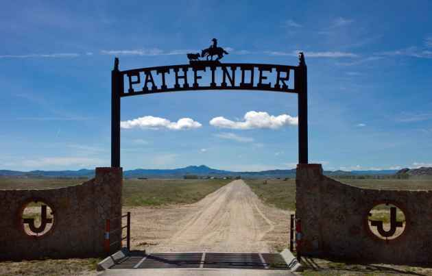 """Entrance to the Pathfinder Ranch southwest of Casper where ranch owners and neighbors have set up a company to deal in """"habitat conservation credits."""" The goal is to improve habitat at Pathfinder ranches when development mars other greater sage grouse core habitat. (Angus M. Thuermer Jr./WyoFile)"""