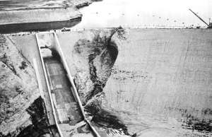 """Fontenelle Dam almost failed soon after it was built and filled in 1965, but emergency action saved the day. After that, the Bureau of Reclamation used 203,500 sacks of cement to stop """"piping"""" leaks that created the sinkhole, according to a presentation by University of Missouri-Rolla Geology and Engineering Department Chairman Karl F. Hasselmann and others. (University of Missouri)"""
