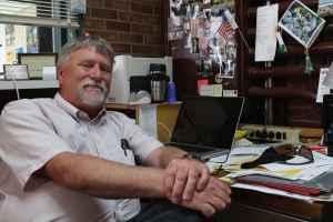 John Freeman at desk