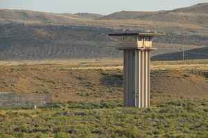 A guard tower at the Wyoming State Penitentiary outside Rawlins. Many people don't see Rawlins' recreational opportunities in nearby mountains and the Red Desert, Burkhart said. (Gregory Nickerson/WyoFile)