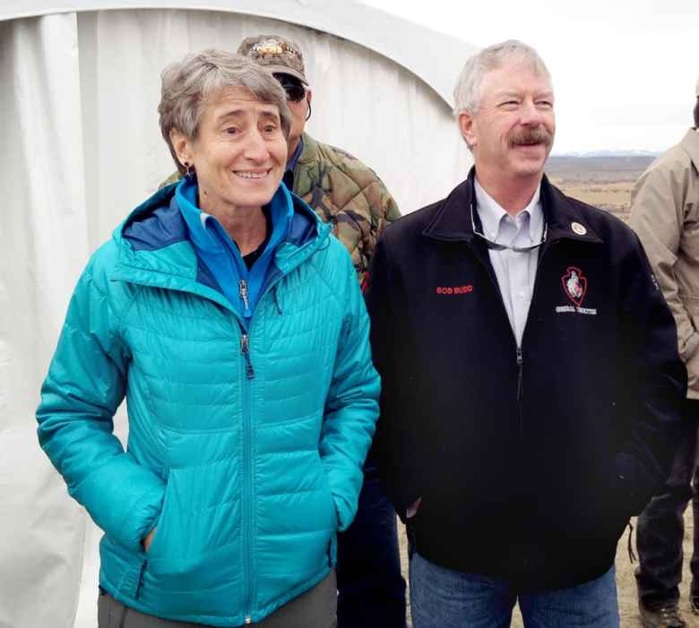 Secretary of the Interior Sally Jewell and Wyoming Sage Grouse Implementation Team Chairman Bob Budd watch migrating antelope near Trappers' Point in Sublette County in October, 2014. Budd had the difficult task of accommodating greater sage grouse and energy development in a state plan. Jewell determined those efforts are sufficient to stave off federal endangered-species protection of the bird. (Angus M. Thuermer Jr./WyoFile)