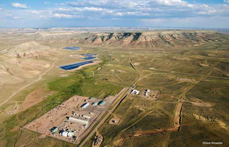 Full scale industrial development in the La Barge, WY oil and gas fields. This fragmented landscape, complete with chemical waste ponds, is only suitable for energy development. (Dave Showalter)