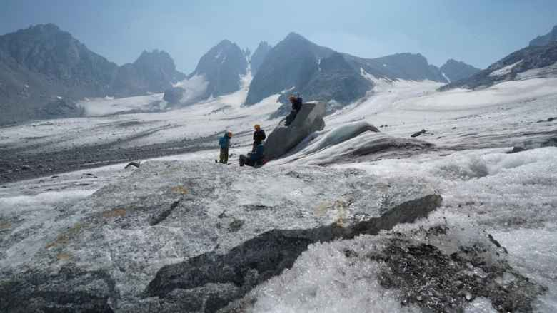 Students take a break from performing GPR data collection on the Dinwoody Glacier. (photo by Kyle Nicholoff)