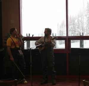 Mark Tuttle and Peter Keenan play music at a church service at the top of the Bridger Gondola at Jackson Hole Mountain resort on Jan. 17. (Photo by Kelsey Dayton)