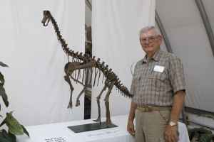 Cliff Manuel, pictured here with a baby brachiosaurus, is giving a free talk on the Bighorn Basin dinosaurs Feb. 3 (Photo courtesy of Cliff Manuel)
