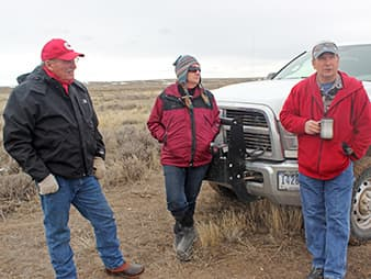 Pat and Sharon O'Toole meet with BLM's rangeland supervisor Andy Warren, right, on the agency's Badwater allotment to discuss the upcoming grazing season and pending sage grouse policy. Photo by Phil Taylor.