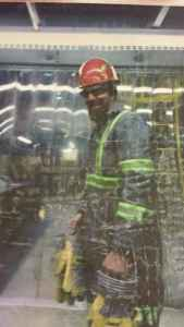 Sean Seems, who left Peabody Energy's North Antelope Rochelle mine in 2015 to work at a gold mine in Alaska, stands behind a plastic screen. (Courtesy)
