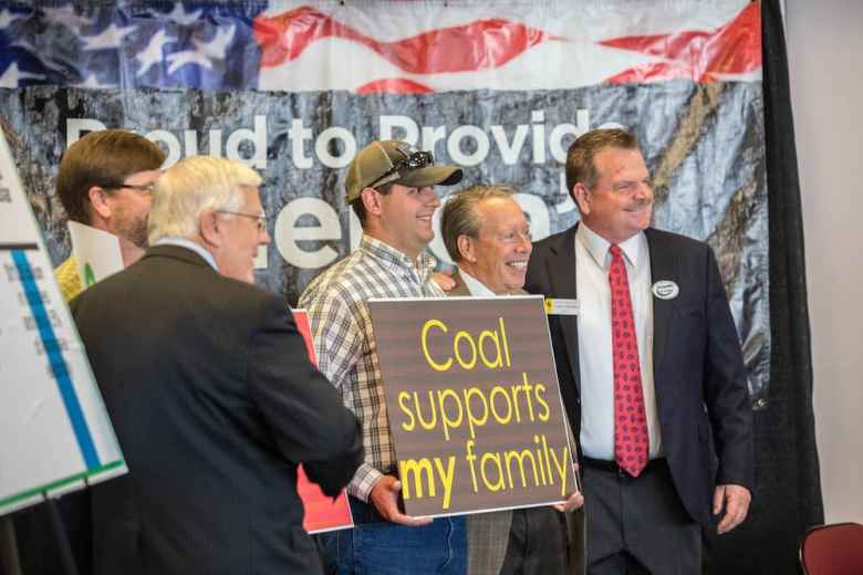 Sen. Leland Christensen, right, appeared recently in Casper at a rally supporting coal mining as he stumped the state as a candidate for the U.S. House of Representatives. The co-chairman of the Joint Judiciary Committee, which is charged with reviewing marijuana laws and fulfilling lawmakers' desire to see a felony statute for cannabis edibles, he chaired a hearing last month in Rock Springs where he heard disparate views on the value and dangers of marijuana. (Tim Kupsick/WyoFile)