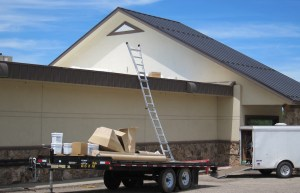 An un-manned ladder rests on a work trailer at a Casper restaurant. While Wyoming worker's comp division guesses that 120 to 200 of the 12,000 new claims filed each year are fraudulent, they know for sure that employers are delinquent in paying premiums to the tune of $3.3 million. (Dustin Bleizeffer/WyoFile)