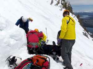 Rescuers treat Jesse Stover on Teewinot in June 2011. Stover's rescue is the subject of Teton County Search and Rescue's first podcast. (courtesy Teton County Search and Rescue)