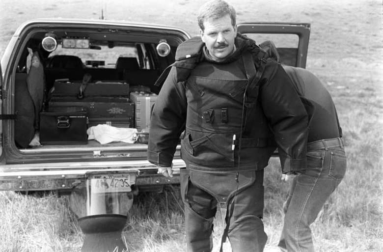 U.S. House candidate Leland Christensen, seen here as a sheriff's deputy getting ready to detonate an unexploded avalanche round from Teton Pass, has touted his life in Wyoming while campaigning against Liz Cheney, who grew up out of state. Cheney leads the fundraising race for the Aug. 16 Republican Primary, raking in donations from hundreds of Wyoming residents. (Jackson Hole News&Guide)