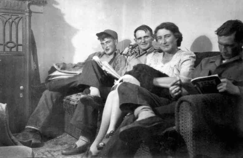 """From left: Lafayette """"Bud"""" Bell, Lafe Bell, Hilda Bell and Tom Bell read on the couch at their home in Lander. The Bell family were readers, something Tom Bell continued to do until his death. (Photo courtesy Matt Winters)"""