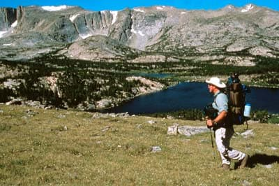 A hiker walks in the Stough Creek area on the Shoshone National Forest. The outdoor industry has reported that, as of 2013, outdoor recreation provided 50,000 jobs and $300 million in state and local tax revenue to Wyoming. (U.S. Forest Service)