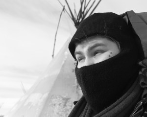Lott, who goes by the name Big Wind, left Riverton to join the Oceti Sakowin Camp near the Standing Rock Indian Reservation. His tipi is his winter quarters where he flies the Arapaho flag and works with camp security. (Angus M. Thuermer Jr./WyoFile)