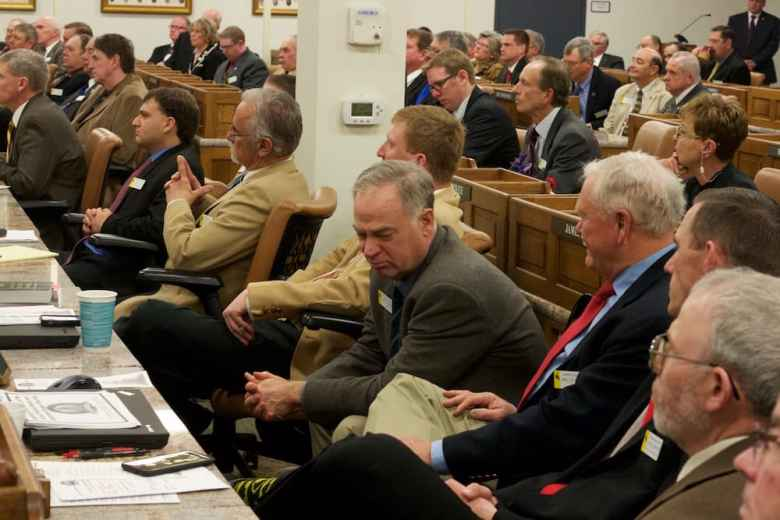 Lawmakers listen to Gov. Matt Mead's state of the state address on Jan. 11. They wrestle this session with how to make up for declining revenue from oil, gas and coal. (Andrew Graham/WyoFile)
