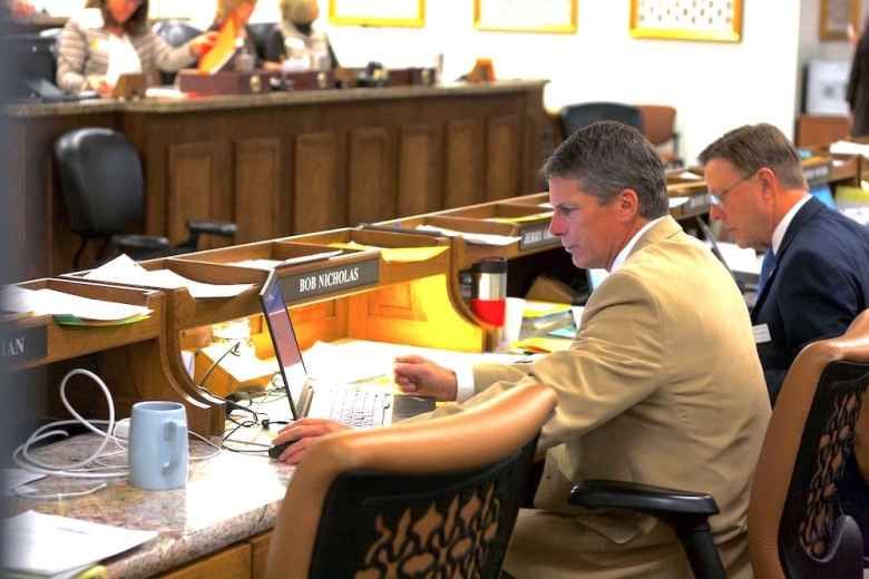 Rep. Bob Nicholas (R, HD-8, Cheyenne) works on his computer on the House floor on Jan. 18. Nicholas, the chairman of the House Appropriations Committee, said some Wyoming residents may not want the state to fully fund the tribal liaison positions. (Andrew Graham/WyoFile)