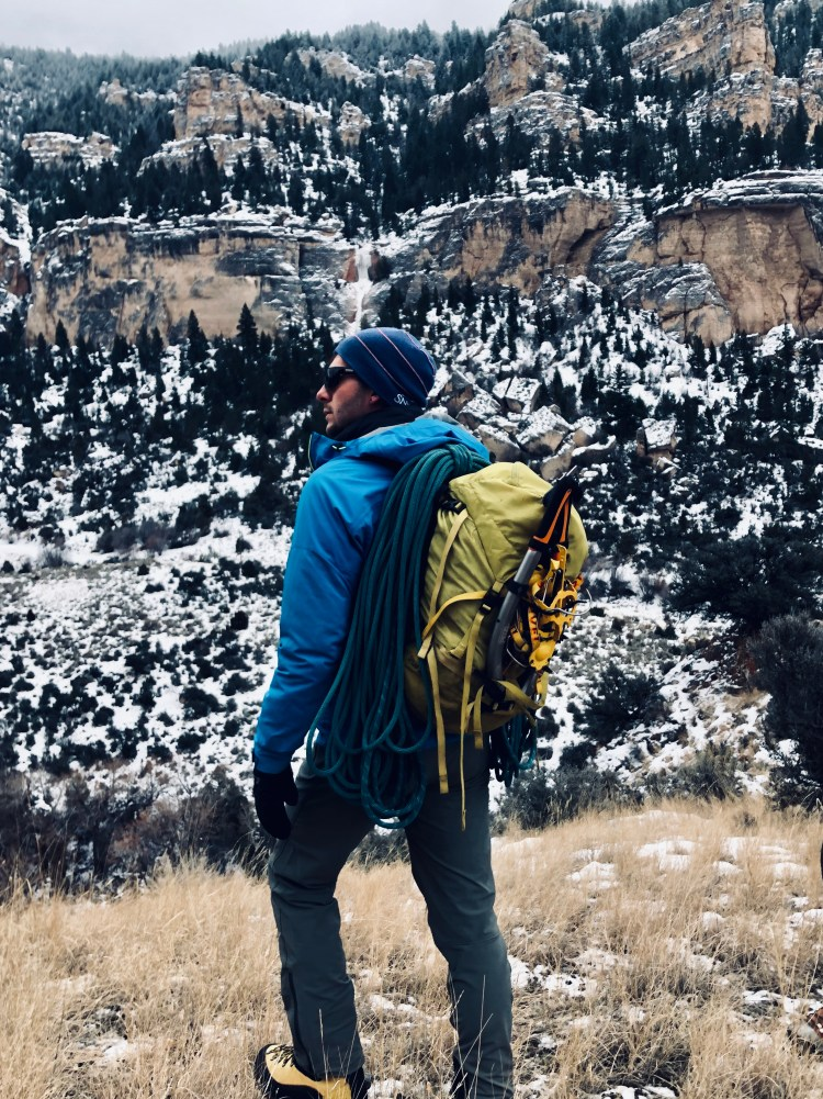 Ice climbing guide Taylor Nielson on the approach to Leigh Creek Falls in Ten Sleep Canyon