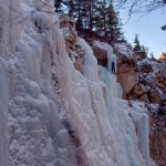 Learn to ice climb on the natural ice parks in the Bighorn Mountains. Photo of a toprope session in Melody Falls, Cottonwood Canyon near Lovell Wyoming