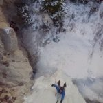 Birds' eye view of one of our guides leading a hard pitch of ice in Melody Falls in Cottonwood Canyon, not far from Bighorn National Recreation Area