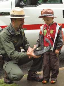 A Park Ranger and a Junior ranger interact during a previous event.