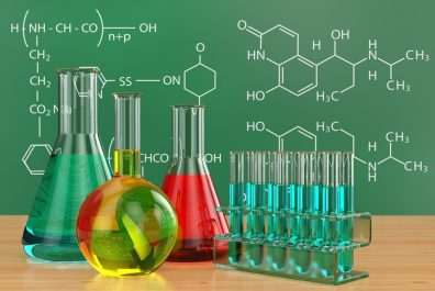 Chemical flasks and blackboard with formulas.