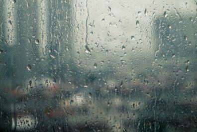 raindrops-trickling-down-on-window-during-heavy-rain_67721-447