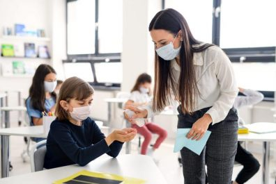 teacher-children-with-face-mask-at-school-after-co-RE358NB-min-scaled