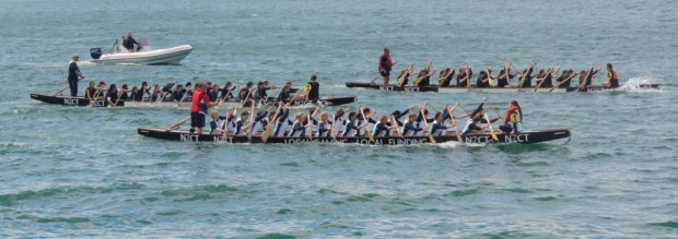 Dragon boat racing on the seafront.