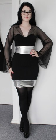 Black bodycon dress with sweetheart faux neckline, silver spandex detail and full mesh sleeves.