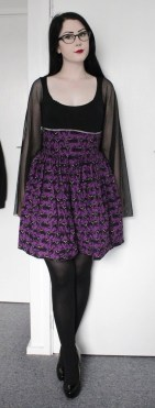 Stretch cotton top with full mesh sleeves. Super high-waisted purple with black cat halloween print cotton full gathered skirt.