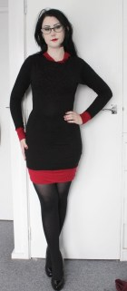 Stretch black bodycon dress with red contrast and snowflake stitching detail.