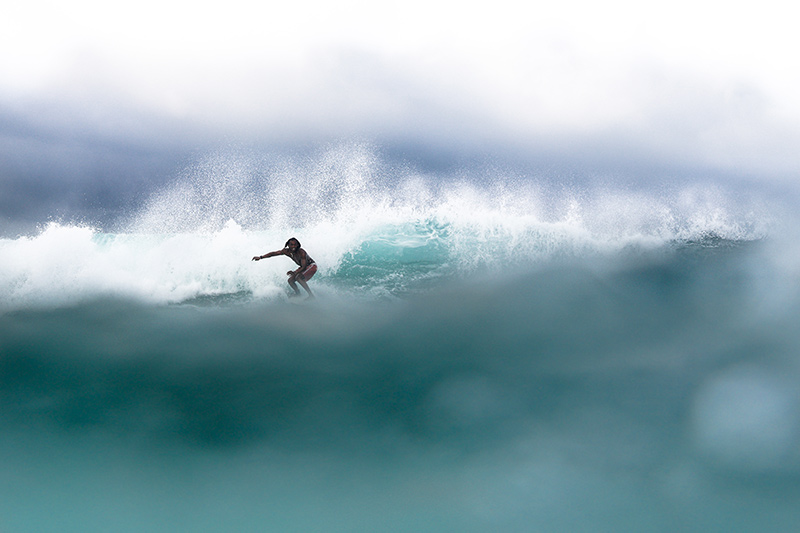 Surfer at one of the best waves in Lombok, Ekas