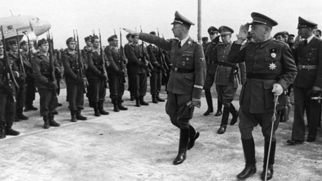 El 23 de octubre de 1940, en plena Segunda Guerra Mundial, el dirigente nazi Heinrich Himmler viajó a Barcelona. Colaboradores