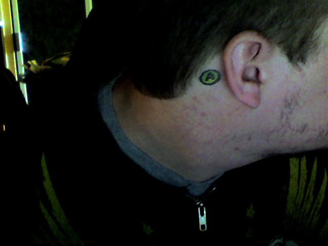 not know I have a tattoo of the XBOX 360's A Button behind my right ear.