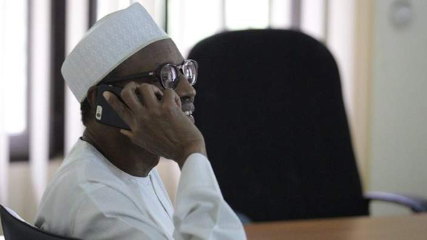 President-elect General Buhari taking a call from President Jonathan who called to congratulate him