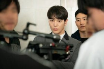Joo Won is seen monitoring their scenes with utmost seriousness.