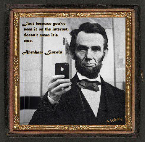 Abe Lincoln using his iPhone.