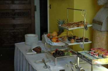 Bread, fruit and pastries selection