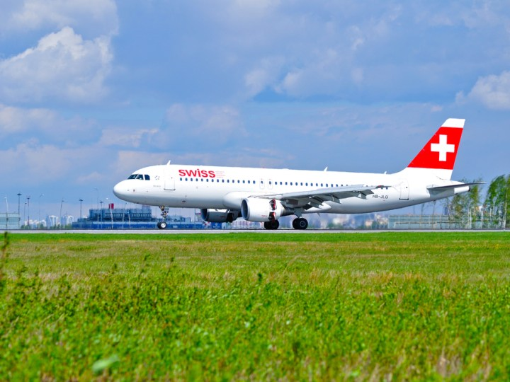 SWISS plane on runway awaiting takeoff
