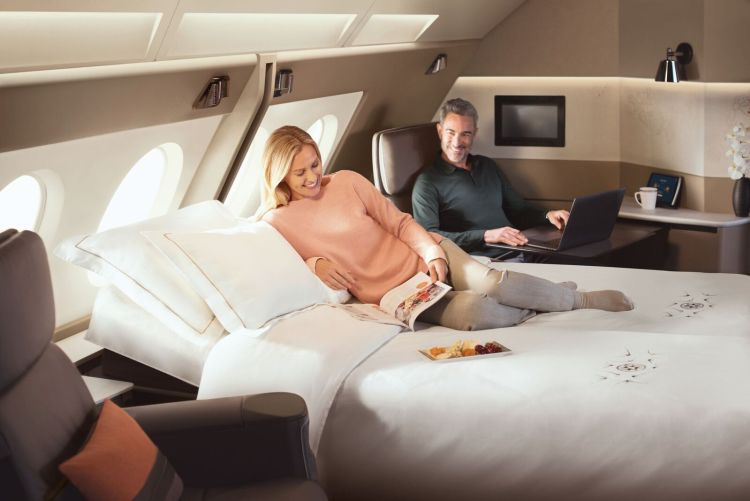 Couple relaxing in SQ A380 Suites.jpeg