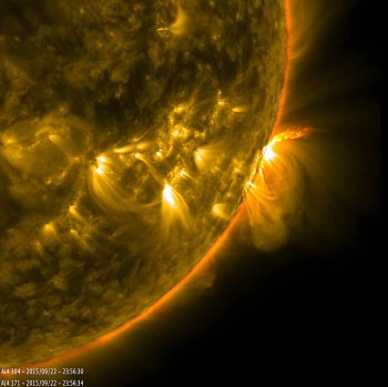 An active region viewed in profile put on quite a show of erupting plasma and looping arches on Sept. 22-23, 2015. The loops, seen above the sun's surface on the right, are light emissions from charged particles spinning along magnetic field lines that dance through the sun's atmosphere. The region, which appeared as a sunspot group in visible light, was observed here in two wavelengths of extreme ultraviolet light over a period of about 40 hours. Though invisible to our eyes, light emissions in the extreme ultraviolet wavelength of 171 Angstroms are typically colorized in gold, while emissions in 304 angstroms are colorized in red. Bild och text kommer från denna artikel på NASA:s webbplats.