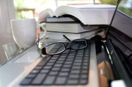 books and laptop for seo and sem