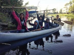Warrior youth who dance to resist and paddle to protect