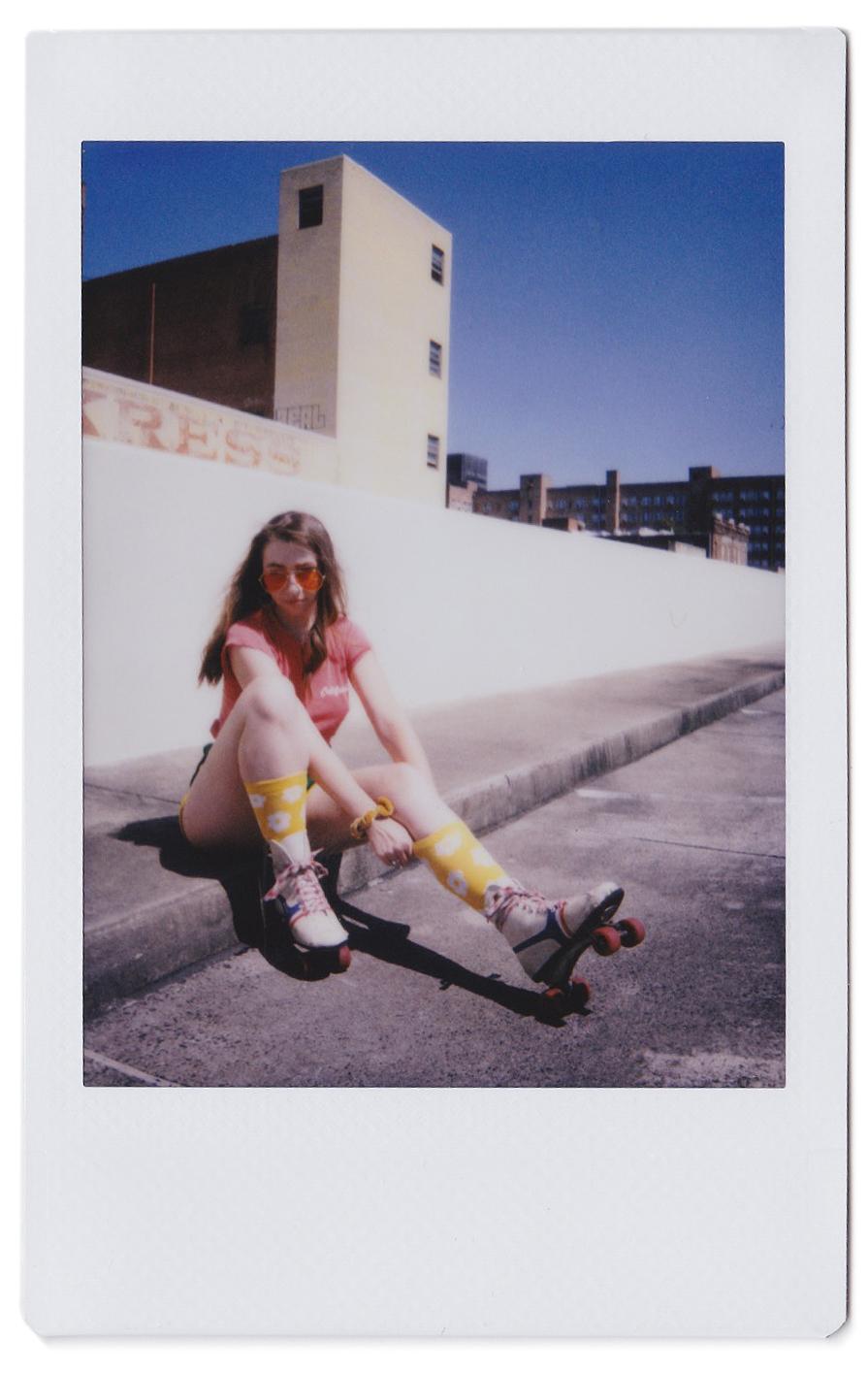 vintage polaroid scan of girl wearing roller skates
