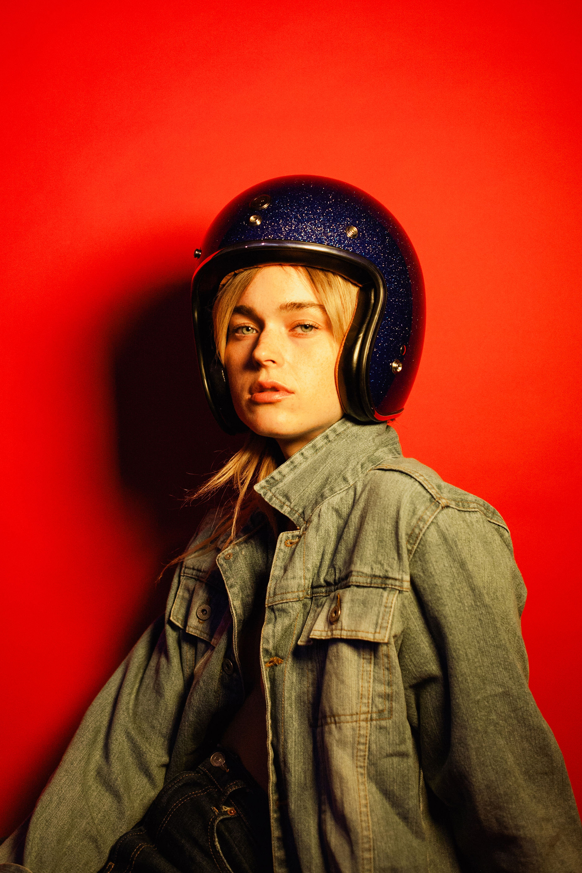 woman with helmet on red background