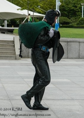 Pearl Diver walking home carrying a net full on his back and his flippers.
